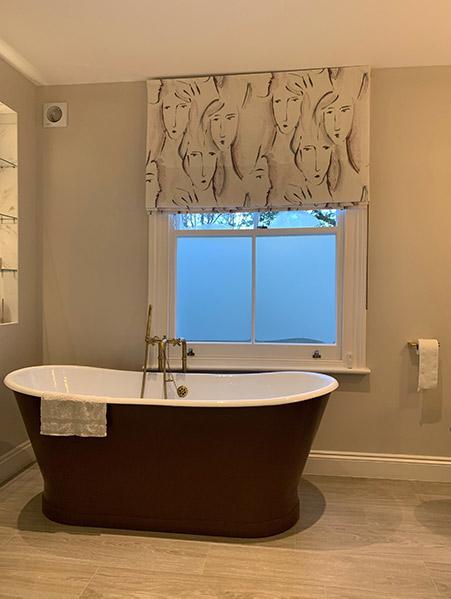 stylish blind behind bath